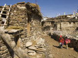 Two Schoolchildren and Typical Stone Houses on Village Street, Nako, Spiti, Himachal Pradesh, India Photographic Print by Simanor Eitan