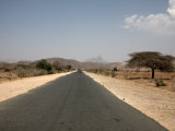 An Empty Road and the Barren Landscape of Western Eritrea, Africa Photographic Print by Mcconnell Andrew