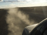 Dust Kicks Up from Behind of Car in Patagonia, on the Infamous Route 40, Southern Argentina Photographic Print by McCoy Aaron