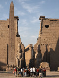 Tourists Gather at Luxor Temple, Luxor, Thebes, UNESCO World Heritage Site, Egypt Photographic Print by Mcconnell Andrew