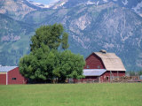 Farm Buildings with Mountain Slopes Behind, Jackson Hole, Wyoming, USA Photographic Print by Mcleod Rob