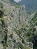 Walkers on a Narrow Mountain Road Above the Cares Gorge in the Picos De Europa, Cantabria, Spain Photographic Print by Maxwell Duncan