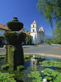 Fountain with Water Lilies, the Mission in the Background, Santa Barbara, California, USA Photographic Print by Tomlinson Ruth