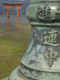 Bronze Pole with Chinese Characters in Foreground, Itsuku Shima Jinja, Miyajima, Honshu, Japan Photographic Print by Simanor Eitan