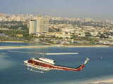 Helicopter over Abu Dhabi, U.A.E., Middle East Photographic Print by Ryan Peter