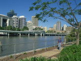 Tourist Walking Beside the Brisbane River and the City Skyline, Brisbane, Queensland, Australia Photographic Print by Richardson Rolf