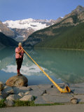 Man with an Alpenhorn Beside Lake Louise in the Banff National Park, Alberta, Canada, North America Photographic Print by Renner Geoff