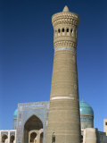 Kalon Minaret with Mir-I-Arab Medressa Behind, Bukhara, Uzbekistan, Central Asia Photographic Print by Waltham Tony
