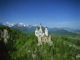 Neuschwanstein Castle on a Wooded Hill with Mountains in the Background, in Bavaria, Germany Photographic Print