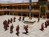 Group of Monks in the Monastery Courtyard Rehearsing for Hemis Festival, Hemis, Ladakh, India Photographic Print by Simanor Eitan