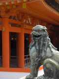 Bronze Lion with Traditional Orange Wooden Roof Beyond, Itsuku Shima Jinja, Miyajima, Honshu, Japan Photographic Print by Simanor Eitan