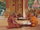 Group of Buddhist Monks in Saffron Robes Sitting on the Floor, Wat Chan in Vientiane, Laos Photographic Print by Taylor Liba