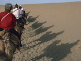 Shadows of Tourists on Camels, Dunhuang Province, China Photographic Print by Sassoon Sybil