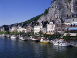 Boats Line the Waterfront on the River Meuse in the Old Town of Dinant in the Ardennes, Belgium Photographic Print by Merten Hans Peter