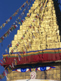 Buddha's Eyes on Gold Leaf Spire, One of the World's Largest Stupas, Boudhanath, Kathmandu, Nepal Photographic Print by Waltham Tony
