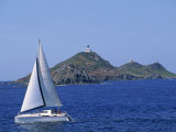 Sailing Boat with the Semaphore Lighthouse Behind, Iles Sanguinaires, Island of Corsica, France Photographic Print by Thouvenin Guy