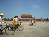 People Cycling Through Tiananmen Square Outside the Forbidden City, Beijing, China Photographic Print by Scholey Peter