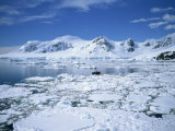 Seascape with Ice and Snow, and People Ice Cruising in Zodiac, Antarctic Peninsula, Antarctica Photographic Print by Renner Geoff