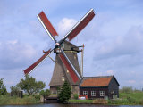 Thatched Windmill on the Canal at Kindersdijk, the Netherlands, Europe Photographic Print by Scholey Peter