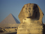 Sphinx and One of the Pyramids at Giza, UNESCO World Heritage Site, Cairo, Egypt Photographic Print by Simanor Eitan