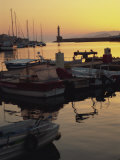 Moored Boats in the Harbour and the Lighthouse Silhouetted on the Horizon, Chania, Crete, Greece Photographic Print by Terry Sheila