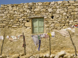 Washing Line in Front of an Old Stone Wall with Small Window at Kastri on Gavdos, Greece, Europe Photographic Print by Ryan Peter