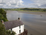Taf Estuary with Dylan Thomas Boathouse, Laugharne, Carmarthenshire, South Wales, United Kingdom Photographic Print by Pottage Julian