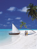 Couple Walking on Tropical Beach and Traditional Dhoni, Maldives, Indian Ocean Photographic Print by Papadopoulos Sakis