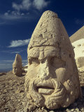 Statue Head Portraying Zeus, and Antiochos in Background, Nemrut Dag, Anatolia, Turkey Photographic Print by Woolfitt Adam