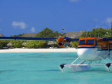 Maldivian Air Taxi Parked in a Resort in Maldives, Indian Ocean Photographic Print by Papadopoulos Sakis