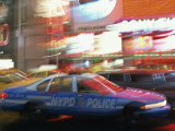 Nypd Police Car Speeding Through Times Square, New York City, New York, USA Photographic Print