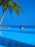 Woman in Swimming Pool under Palm Tree Looking at Sea, Maldives, Indian Ocean Photographic Print by Papadopoulos Sakis