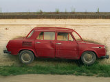 Half a Skoda on a Wall in a Car Salesyard Near Piestany, Slovakia, Europe Photographic Print by Strachan James