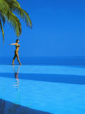 Woman Balancing on Edge of Infinity Pool, Maldives, Indian Ocean Photographic Print by Papadopoulos Sakis