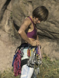Female Rock Climber Preparing Her Equipment Photographic Print