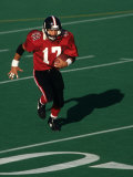 Football Running Back in Action Photographic Print