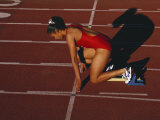 Female Runner at the Start of a Track Race Photographic Print