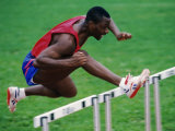 Male Hurdler in Action Photographic Print by Paul Sutton