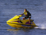 Teenage Boy Riding His Jetski Photographic Print
