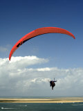 Red Hang Glider over Bay of Arcachon, Gironde, Aquitaine, France, Europe Photographic Print by Groenendijk Peter