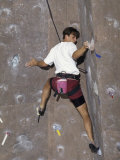 Man Wall Climbing Indoors with Equipment Photographic Print