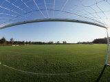 View of Soccer Field Through Goal Photographie par Steven Sutton