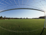 View of Soccer Field Through Goal Fotografie-Druck von Steven Sutton