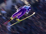 Blurred Action of Ski Jumper Flying Throught the Air Photographic Print