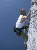Male Rock Climber Reaching for a Grip Photographic Print