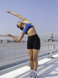 Woman Stretching Outdoors, New York, New York, USA Photographic Print by Chris Trotman