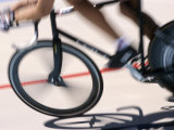 Detail of Blurred Action of Cyclist Competing on the Velodrome Stampa fotografica