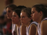 Teenage Girls Basketball Team Watching the Game from the Bench Photographic Print