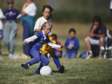 8 Year Old Girls in Action Durring Soccer Game, Lakewood, Colorado, USA Photographie