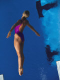 Female Diver in Action Off the Springboard Photographic Print